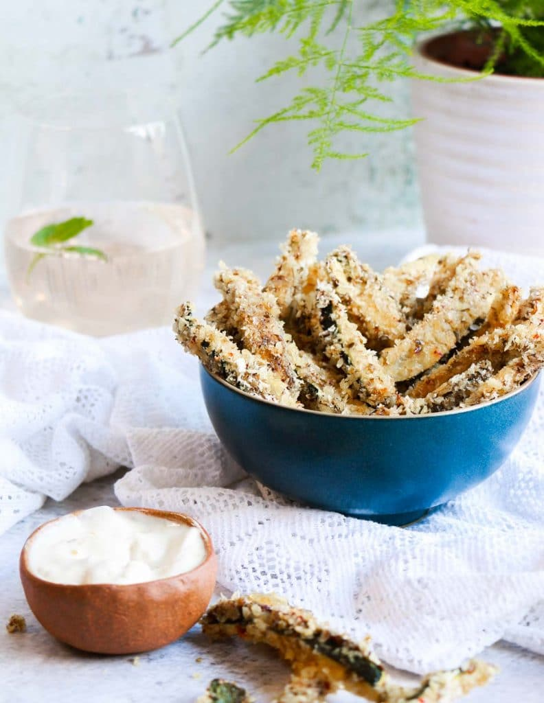 Vegan Zucchini fries in a bowl with vegan mayo in front!