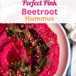 Beetroot hummus, very pink in a bowl.
