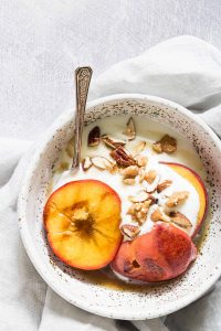 Grilled peaches in a bowl with yoghurt