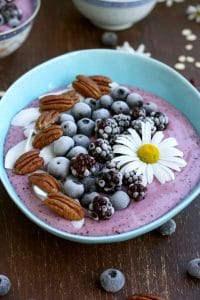 vegan smoothie bowl topped with fruit