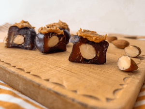 Three vegan snickers candies on a board