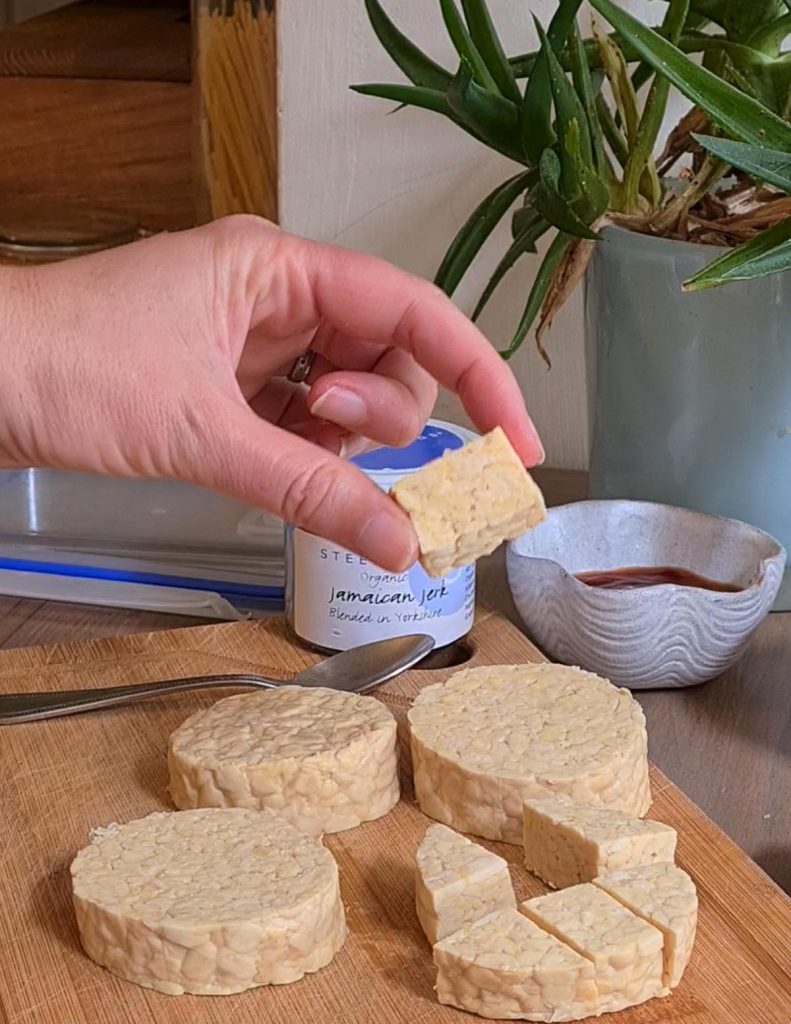 tempeh being cut into pieces