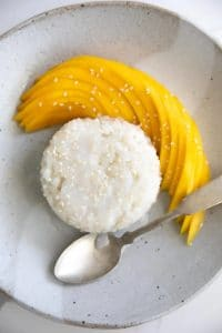Thai Mango Sticky Rice on a plate with a spoon