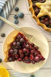 Slice of vegan blueberry pie on a plate