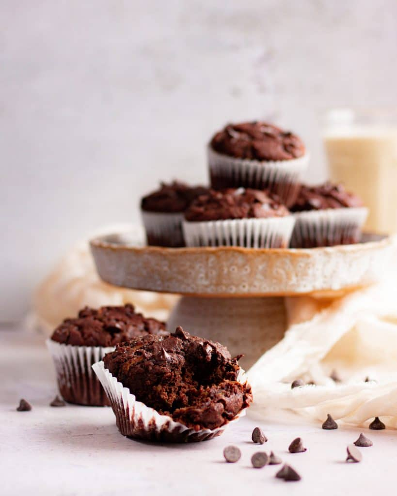 a chocolate muffin broken up to reveal the moist inside
