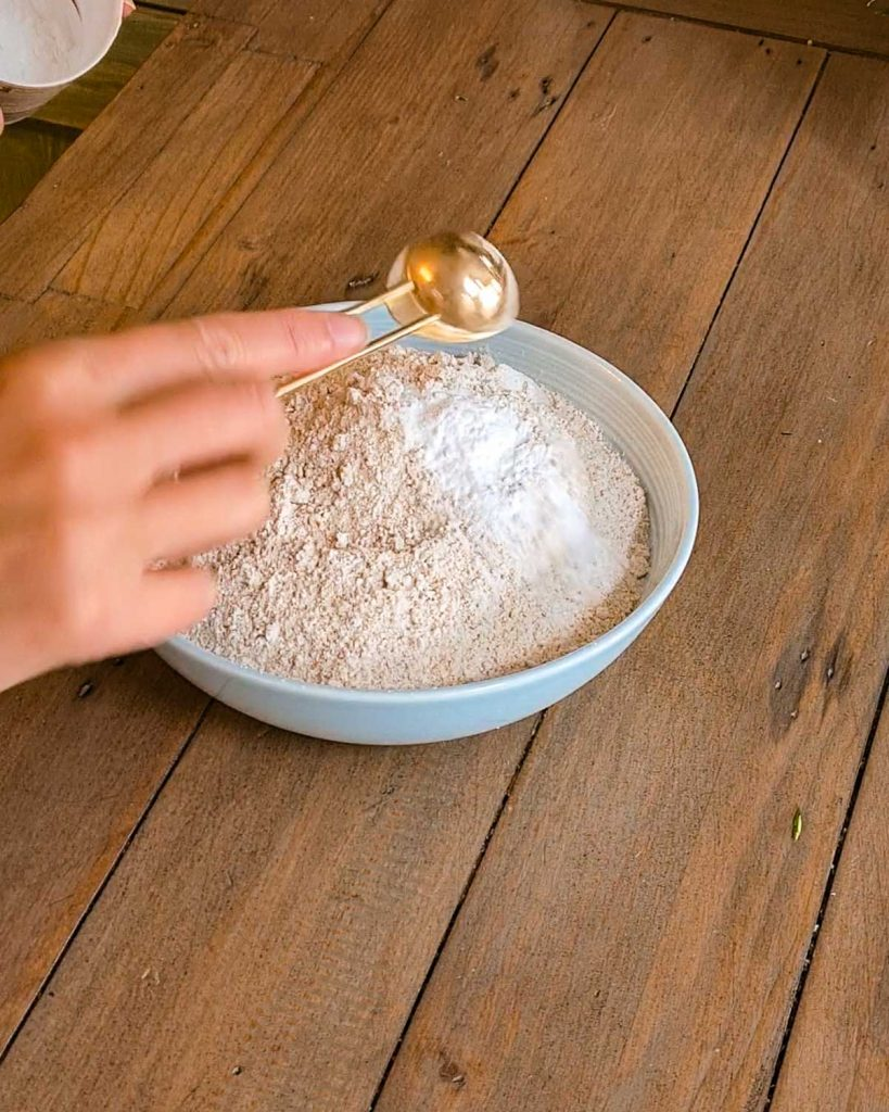 flour in a bowl with baking powder