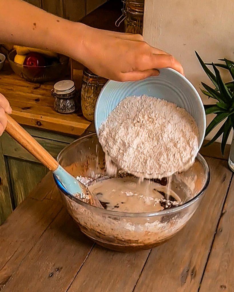 adding flour to the cake mixture