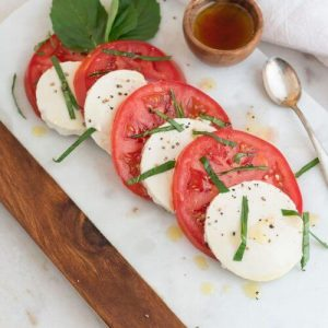 vegan tomato and tofu caprese salad on a plate