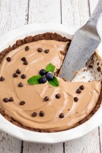 vegan chocolate no bake pie with a slice out