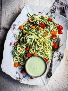 Zucchini noodles on a plate with vegan cream