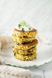 Zucchini Fritters stacked up with raita