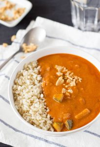 African peanut soup in a bowl with rice