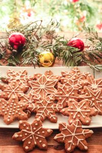 gingerbread cookies with christmas decoration around them