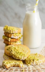pistachio shortbread cookies with a bottle of milk