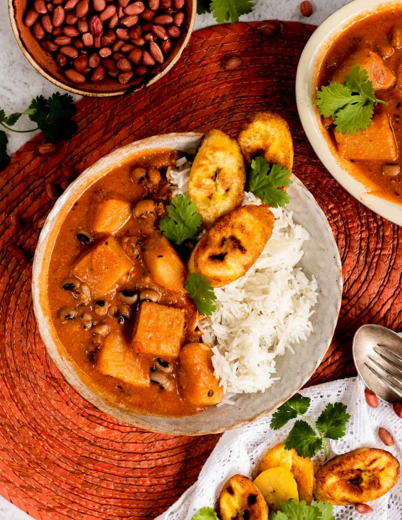 Nigerian stew with yams and peanut butter in a bowl with rice