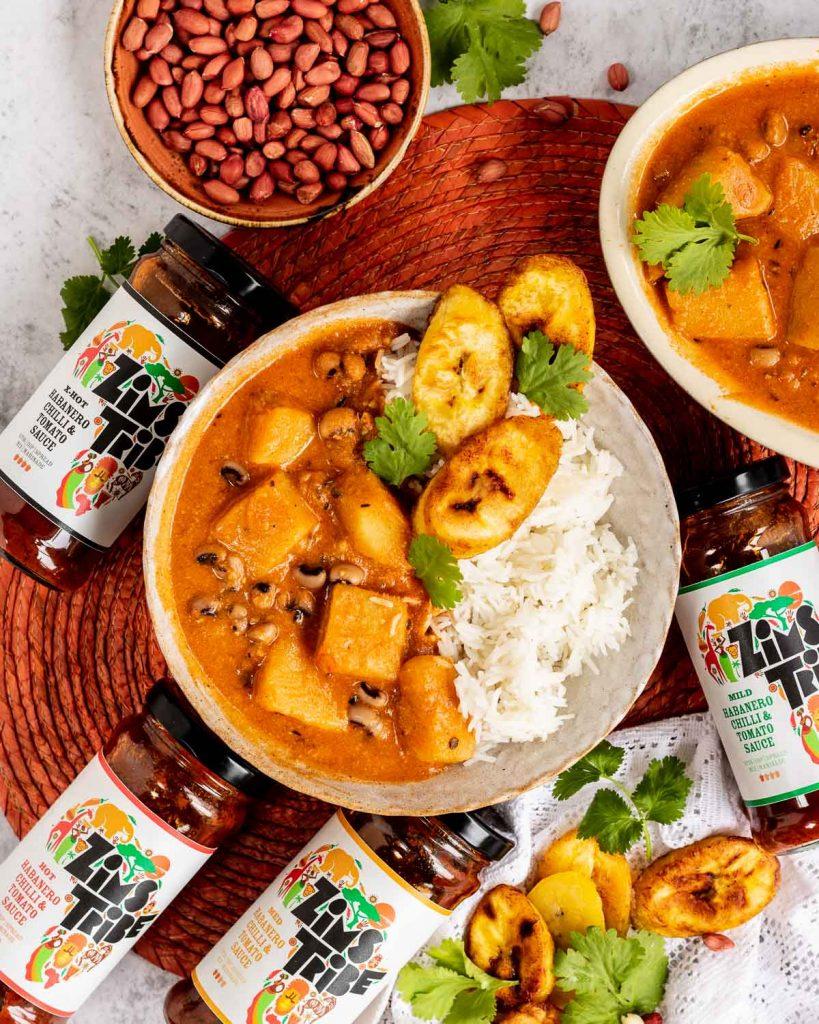 Nigerian stew with jars of Zim's Tribe sauce