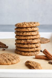 spiced tahini oatmeal christmas cookies in a stack